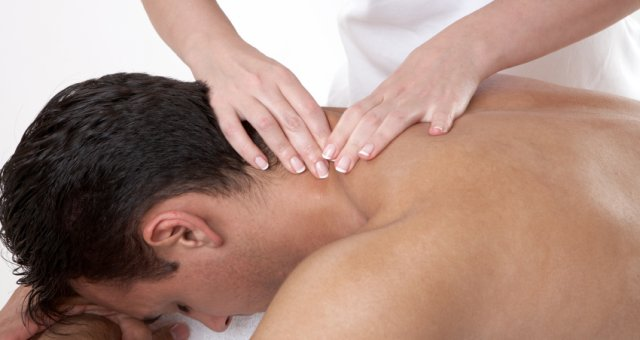 Hands massaging a man's neck